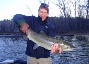Mark with a Muskegon river steelhead