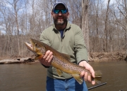 Josh with an awesome 24 inch Muskegon river brown