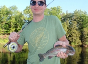 Brad with his first ever trout caught on a fly rod