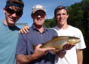 John & his two sons with a really nice brown trout caught w/dry fly