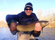 Chris holding an outstanding 25inch Muskegon River Brown Trout