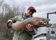 Paul with a long crimson red spring steelhead