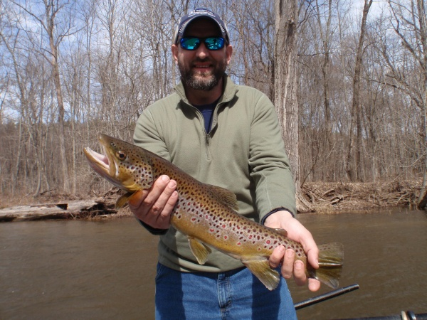 Josh with a 22 inch Muskegon River Brown Trout