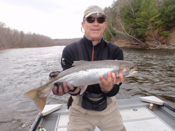 Joe with a nice chrome Muskegon river steelhead