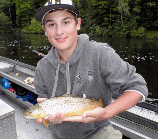 Jimmy with a really nice Muskegon river brown trout caught on a dry fly